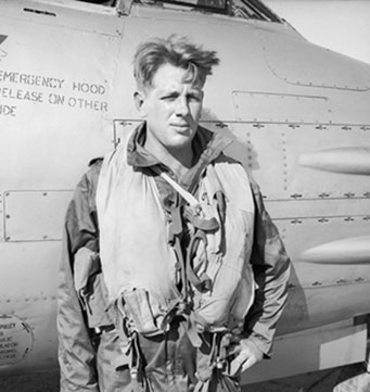 A33624 Sergeant (later Pilot Officer) Vance Drummond, of No. 77 Squadron RAAF beside his Gloster Meteor F.8 aircraft, Kimpo, South Korea. 1951 Australian War Memorial JK0163