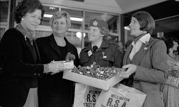 An RNZAF airwoman helps with the RSA's Poppy Day street appeal in Wellington in 1979. Image credit: ©RNZAF Official PR2334-8~79