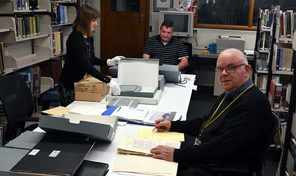 Researchers accessing archival collections in the Reading Room at the Air Force Museum of New Zealand.