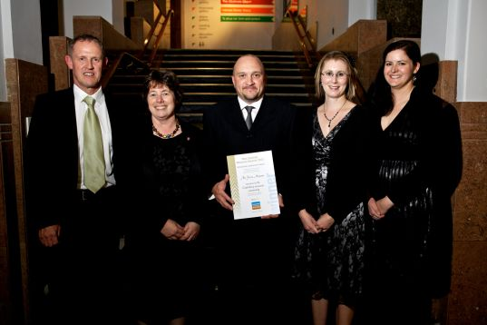 Thérèse and members of her team, including, at left, then Deputy Chief of Air Force Air Commodore Kevin Short (now Air Marshal, Chief of Defence Force), after receiving a special award from Museums Aotearoa for support provided to colleagues in the heritage sector after the 2010/2011 earthquakes. National Museum Awards, 2012. Image: Museums Aotearoa.