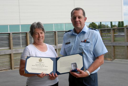 Receiving her second Chief of Air Force Commendation from then Chief of Air Force, Air Vice-Marshal Mike Yardley.