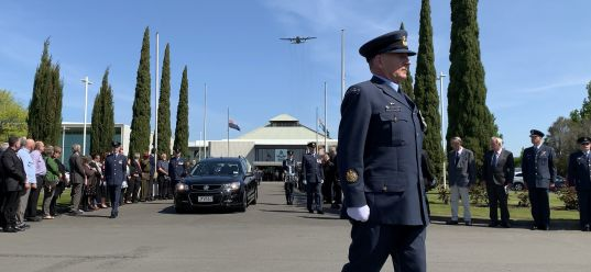 Thérèse departing the Air Force Museum for the final time, as a C-130 Hercules flies overhead in salute. Image: Corporal Ian Brown, RNZAF.