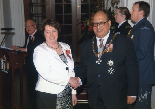 Thérèse having been made a Member of the New Zealand Order of Merit by then Governor-General, Sir Anand Satyanand, 2011. Image: Government House Official.