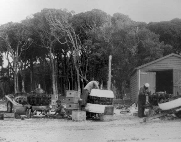 Salvage of Maritime Operational Conversion Unit Sunderland, NZ4111, after it was holed and sank in Te Whanga Lagoon, Chatham Islands. Members of the salvage party stripping the engines for return to New Zealand.