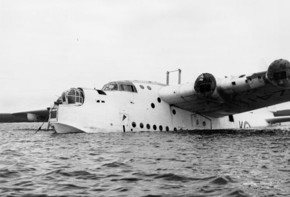 Salvage of Maritime Operational Conversion Unit Sunderland, NZ4111, after it was holed and sank in Te Whanga Lagoon, Chatham Islands. Sunderland lying low in the lagoon.