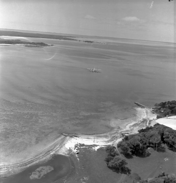 Aerial view of the aircraft in Te Whanga lagoon, Chatham Islands. Image ref: PR2183-R2-10-59 ©RNZAF Official
