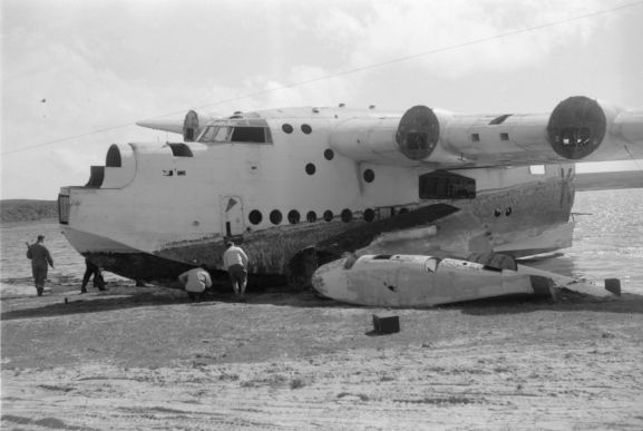 No. 5 Squadron Sunderland NZ4111 being salvaged for parts on the shore of Te Whanga Lagoon on the Chatham Islands.