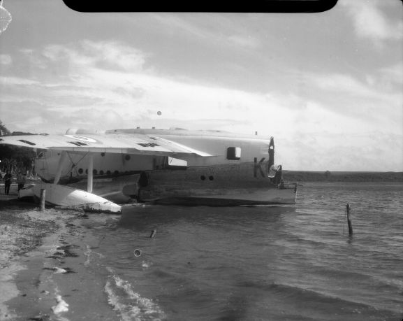 No. 5 Squadron Sunderland NZ4111 being salvaged for parts on the shore of Te Whanga Lagoon on the Chatham Islands. NB. This negative deteriorating resulting in a loss of quality.