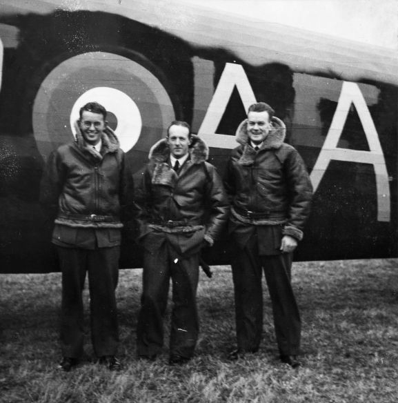 "Image from the No. 75 Squadron collection. Photo album that belonged to Leonard Rodney Hewitt. ""Jim Falconer: LRH: George Key"" Three members of a crew standing beside a No. 75 Squadron Wellington. Believed to be at RAF Station Feltwell. Note the over-painted squadron code letters on the fuselage. No. 75 Squadron's letters 'AA' are painted over a previous identity, believed to be No. 37 Squadron's letters 'LF'."