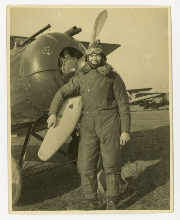 Harry Leese in flying suit, standing by the distinctive nose of an Airco DH-5 of No. 32 Squadron, c late 1917.
