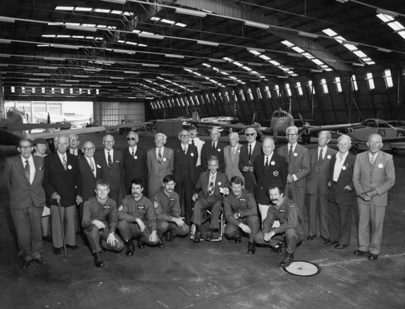 Group of World War One airmen at the 1981 Reunion held at Wigram. Harry Leese is standing fifth from the right in the blazer with a badge. L-R: Standing; HW McFarlane (Christchurch), Flying Officer Lorraine Creighton, John Seabrook (Auckland), RN Munro (Napier), P Pattson (Auckland), CR Williamson (Christchurch), IE Rawnsley (Wellington), CJ Tapper (Gisborne), WW Withell (Christchurch), Leading Aircraftman M Cocker, AT Allen (Christchurch), Arthur PArrish (Auckland), Reg Kingsford (Nelson), HC Leese (Auckland), Harry Walker (Nelson), Eric Flower (Nelson), Tom Leighs (Christchurch), Bill MacPherson (Wanaka). Front; Flight Lieutenant CF Pearce, Flight Lieutenant RS Ginders, Flight Lieutenant FH Parker, A Cassie (New Plymouth)(seated), Flight Lieutenant RA Jannesen, Squadron Leader JS Bates. Absent (but attended reunion); EW Reeves (Christchurch), HG Eldon (Nelson), D Checkley (Blenheim), JF Winn (Wellington).