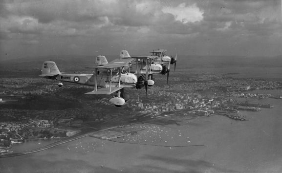 Image from the Alwyn Palmer personal collection.Air to air view of three Vildebeests in formation over Auckland city. From front: NZ103, NZ102, NZ111.