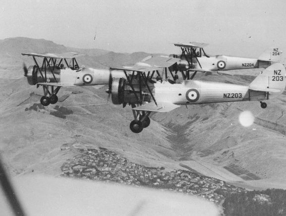 Air to air view of three Avro 626s in formation over the Port Hills, near Christchurch. Near aircraft; NZ203. Far aircraft NZ204. Original negative number WgF184.