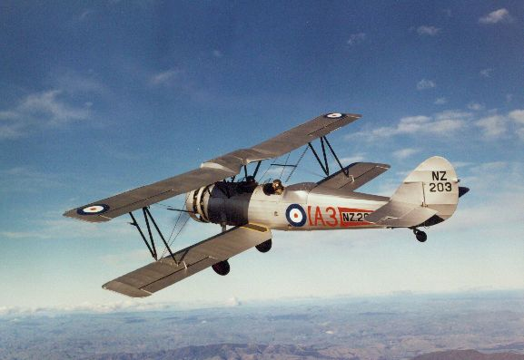 Air to air view of Avro 626 NZ203 in flight over hills after being fully restored.