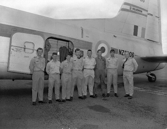 Group of No. 75 Squadron officers pose beside No. 3 Squadron Bristol Freighter NZ5906, before leaving for the USA to convert to Skyhawks. RNZAF Base Ohakea. L-R: Fred (Graeme) Thompson, John Scrimshaw, Ken Cox, Murray Abel, Laurie Lawless (Navigator & Admin), Trevor Bland, Mike Callanan, Ross Ewing. People missing are Roger Henstock, Ken Gayfer, John Woolford. All names supplied by Squadron Leader Jim Jennings, 2004.