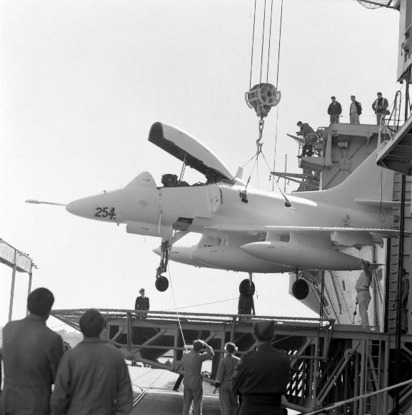 The delivery of the new Skyhawks. A TA-4K labelled 254 (NZ6254?), being lowered from the aircraft carrier U.S.S. Okinawa. Auckland.