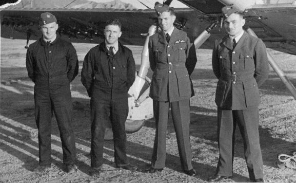 Group standing in front of Vildebeest NZ102 at Rongotai aerodrome during the Air Pageant. L-R: unknown (Rigger), Aircraftman 1 Tucker (Fitter), Pilot Officer LH Trent, Acting Pilot Officer Rankin.