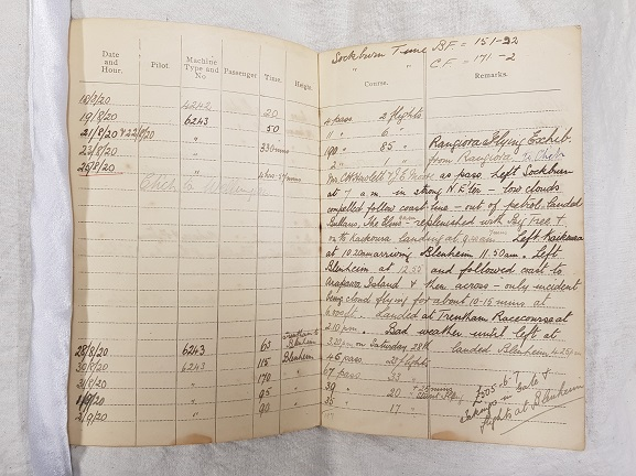 Euan Dickson's flying log book, open at the page with his entry for the first aerial crossing of Cook Strait, 25 August 1920. From the collection of the Air Force Museum of New Zealand.