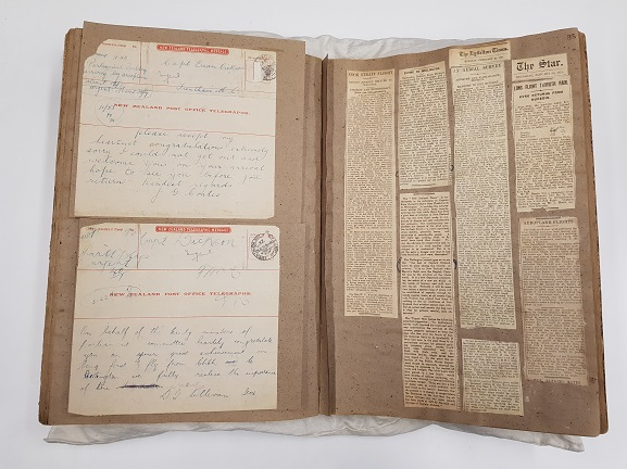 Captain Euan Dickson's personal scrapbook, containing congratulatory telegrams and newsclippings of his history-making flight. From the collection of the Air Force Museum of New Zealand.