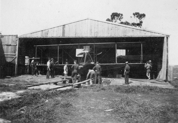 Performing maintenance on a Curtiss flying boat at the New Zealand Flying School, Kohimarama, 1916. From the collection of the Air Force Museum of New Zealand.