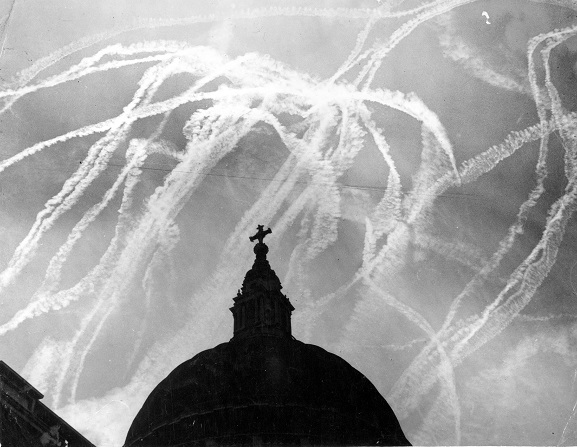 A dog fight in the sky over St. Paul's Cathedral in London during the Battle of Britain.