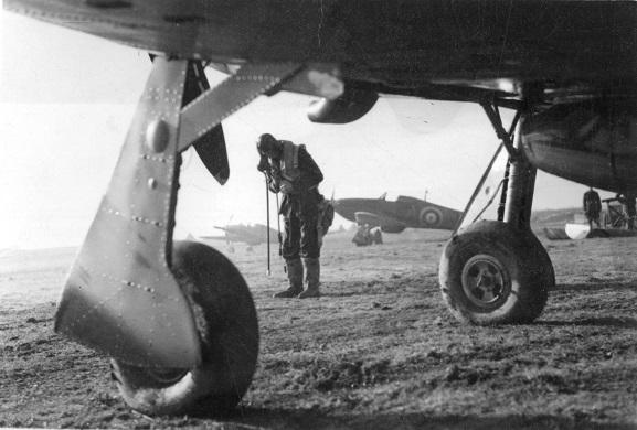 Hurricane pilot prepares his flying equipment before a flight, November 1940.