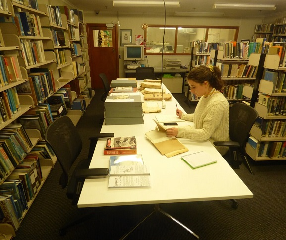Otago University Postgraduate student Stacey Fraser, conducting research for her History dissertation in the Reading Room at the Air Force Museum of New Zealand.