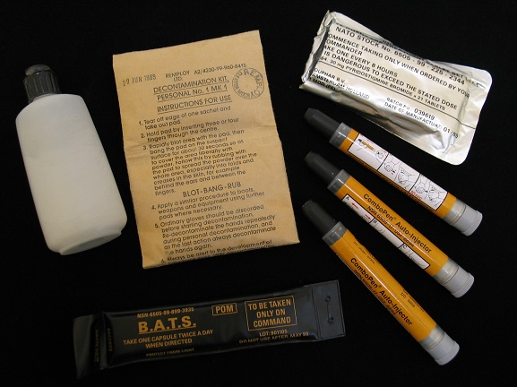 Personal NBC (Nuclear/Biological/Chemical) Warfare Kit, issued to Warrant Officer Pat MacKay during the 1991 Gulf War. Kit consists of olive green carry case containing: rubber gloves with cotton inners; three