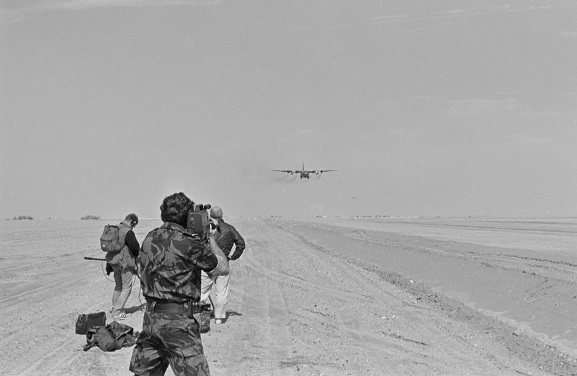 TV film crew shooting a story at a desert airfield in Saudi Arabia. Feb-Mar 1991. Image ref PD17-24-91, RNZAF Official.