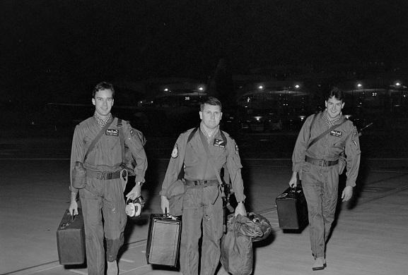 Operation Fresco. No. 40 Squadron crew walking to their aircraft at King Khalid International Airport, Riyadh, Saudi Arabia.  L-R: Flying Officer PR Tighe-Umbers, Squadron Leader DS Forbes-Dawson, Flight Lieutenant DG Wake. Feb-Mar 1991. Image ref PD18-8-91, RNZAF Official.