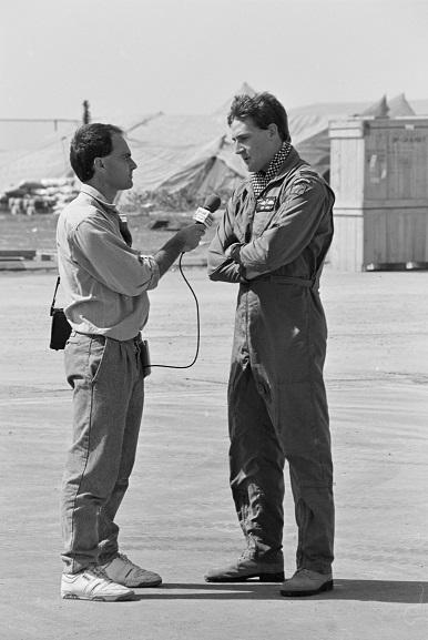 No. 40 Squadron pilot, Flight Lieutenant DG Wake, being interviewed by a Radio News reporter at Al Qaisumah Airport, Saudi Arabia. Feb-Mar 1991. Image ref PD19-22-91, RNZAF Official.