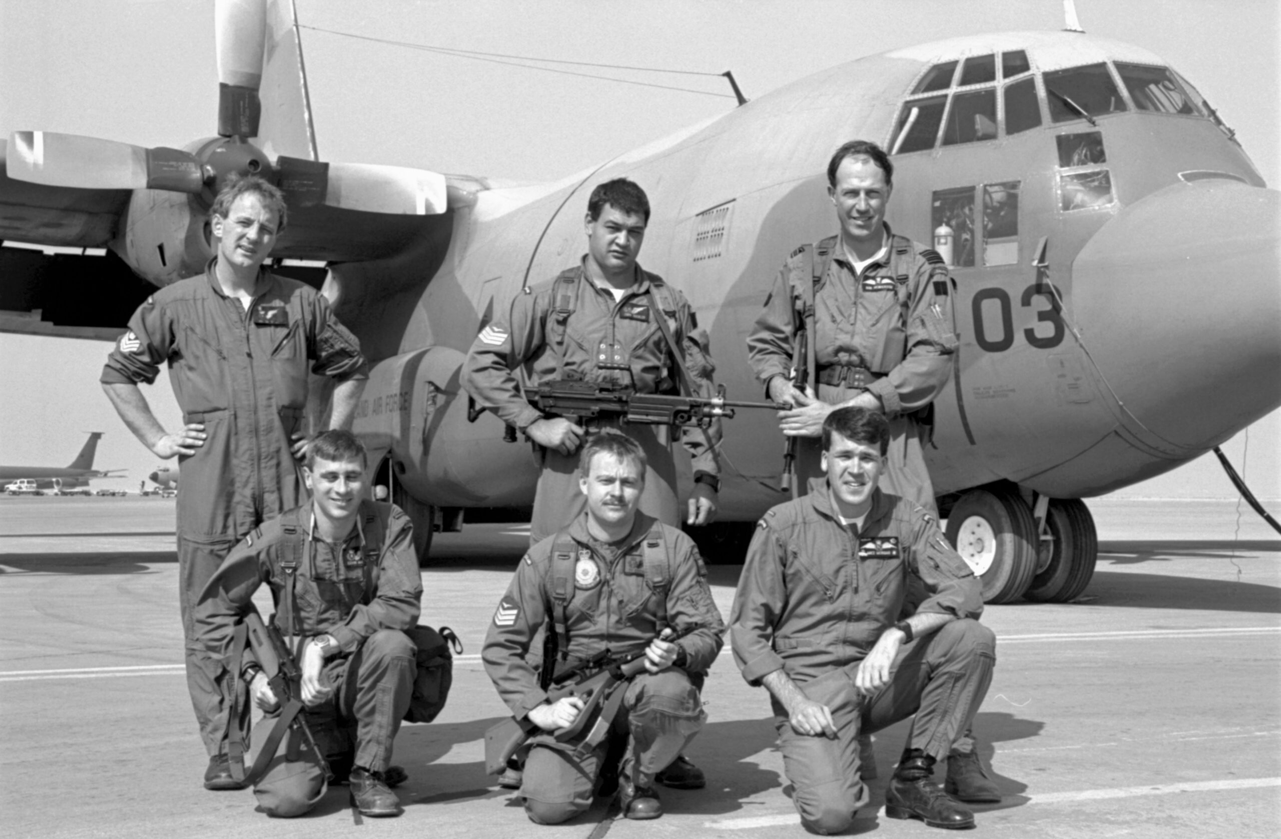 Crew of No. 40 Squadron Hercules NZ7003. Presumed to be at Riyadh, Saudi Arabia, 1991.  L-R: Back; Flight Sergeant Bruce Melvin, Sergeant J Buchler, Wing Commander Robert Henderson (Detachment Commander and aircraft captain) Front; Flying Officer Kevin McEvoy, Sergeant Ty Cochran, Flying Officer M Morgan. Image ref PD21-21-91, RNZAF Official.