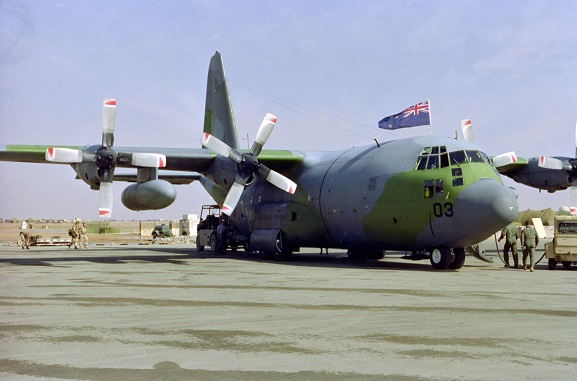 No. 40 Squadron Hercules NZ7003 with a New Zealand flag flying from the cockpit hatch. Presumed to be at King Khalid International Airport, Riyadh, Saudi Arabia, Feb-Mar 1991. Image ref PD29-10-91, RNZAF Official.