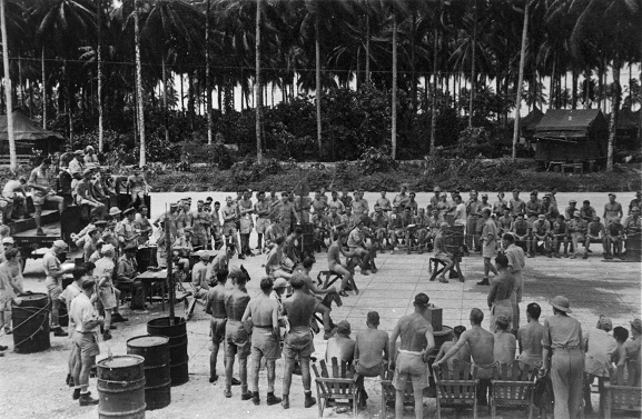 Image from the Keith Hubert Kendon personal album collection.  Military personnel horse racing using wooden horses.  Bougainville, 1945. Image ref ALB940767056, Air Force Museum of New Zealand.