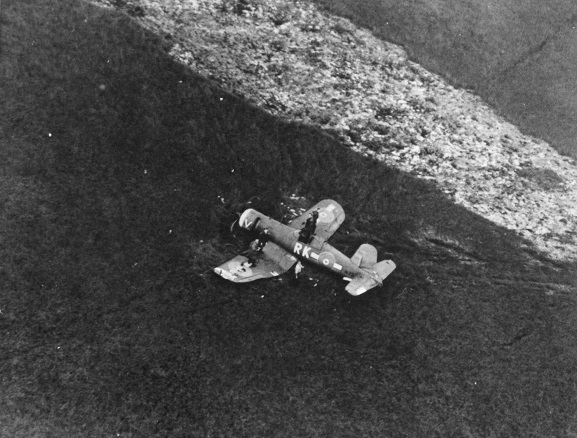 Aerial oblique view of Corsair NZ5320, from No. 3 Servicing Unit, after crash landing in Piako Swamp, 27 October 1944. Image ref HIST489, RNZAF Official.