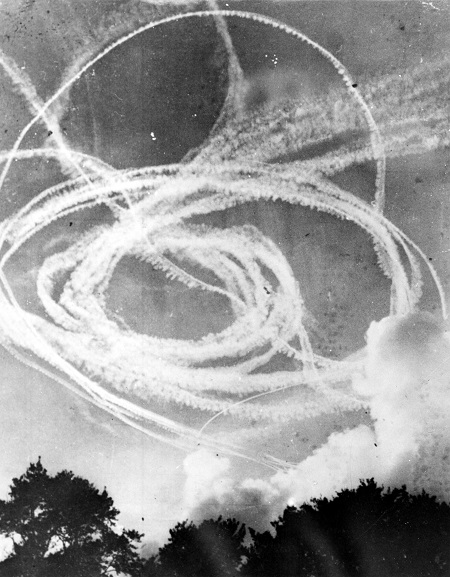 Vapour trails in the sky from a dog fight, believed to be over England. Believed to be during the Battle of Britain, 1940. Image ref MUS06006, Air Force Museum of New Zealand.
