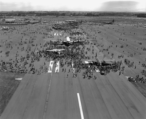 Crowds at the Air Force Day '81 open day at RNZAF Base Ohakea, 28 February 1981. High view of the tarmac with crowds of people looking at the static display aircraft