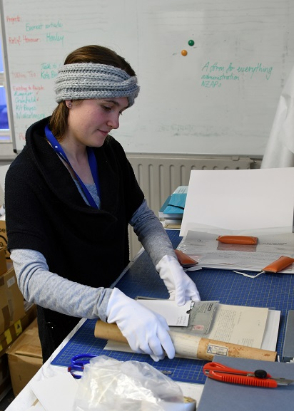Archives Technician, Louisa Hormann, packing a collection of papers at the Air Force Museum of New Zealand. Image ref MUS21109, Air Force Museum of New Zealand.