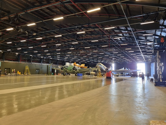 Cleaning the Aircraft Hall, in preparation for the lighting upgrade. 4 May 2021. Image: Air Force Museum of New Zealand.