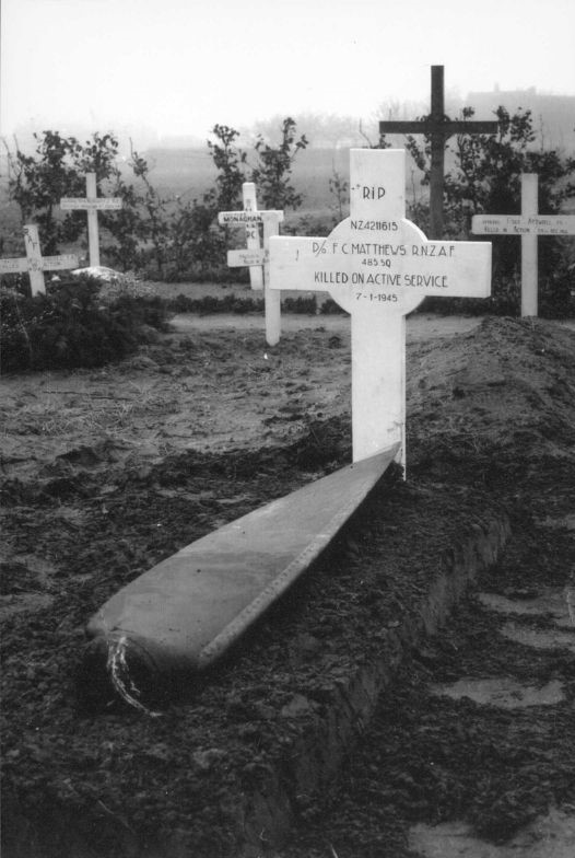 Temporary grave marker of P/O F.C. Matthews with spitfire propellor, Holland