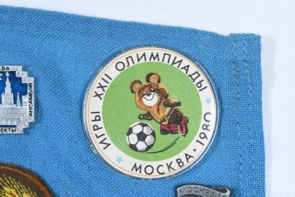 Close up of Misha the Bear badge