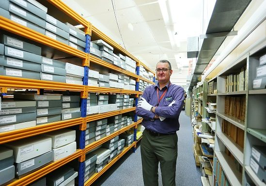 Research Curator Simon Moody, in the main archive store at the Air Force Museum of New Zealand. Image: Air Force Museum of New Zealand.