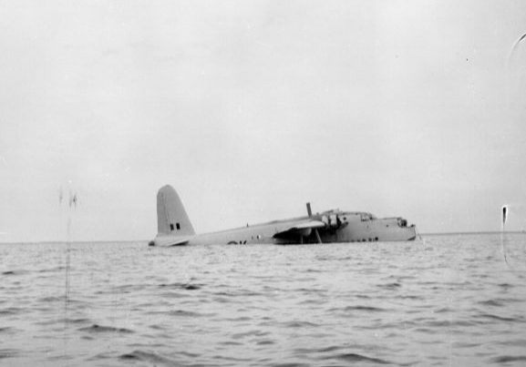 Salvage of Maritime Operational Conversion Unit Sunderland, NZ4111, after it was holed and sank in Te Whanga Lagoon, Chatham Islands. The Sunderland lying low in the water.